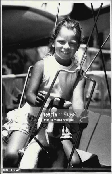 Kids fun at the festival of Sydneyat Circular QuayAnna McCathy 7 of Blue Mtns on Roundabout January 2 1990