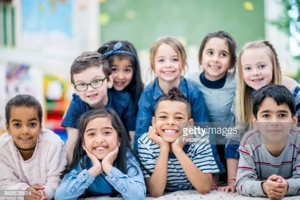 kids fun group photo - class photo stock photos and pictures