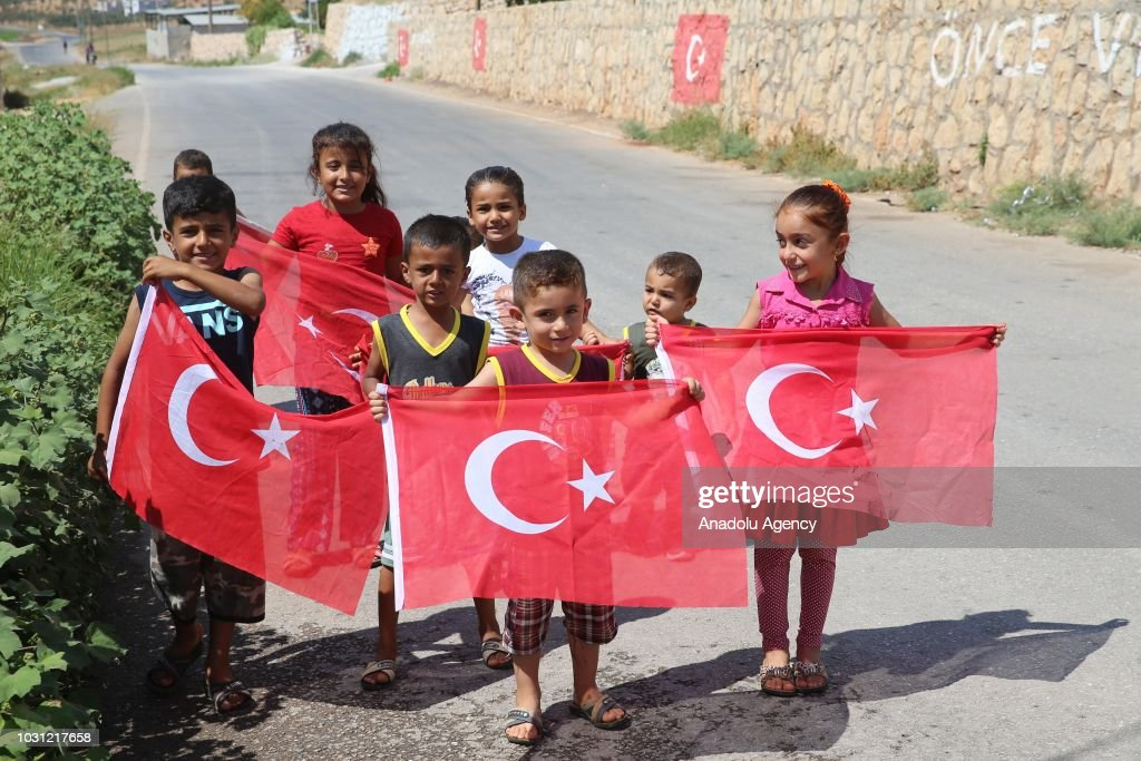 Turkey deploys armored vehicles to syrian border pictures getty images kids gather to greet turkish military convoy as turkish armed forces armoured military vehicles and m4hsunfo