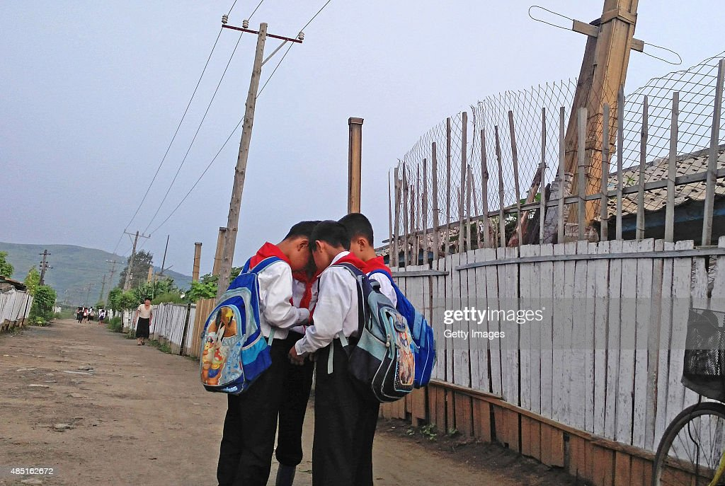 Kids go to school in the morning on August 20, 2015 in Tumangang, North Korea. North and South Korea today came to an agreement to ease tensions following an exchange of artillery fire at the demilitarized border last week.