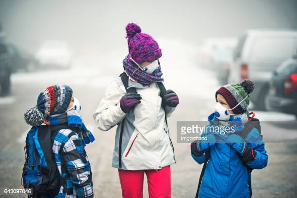 Kids going to school in the smog