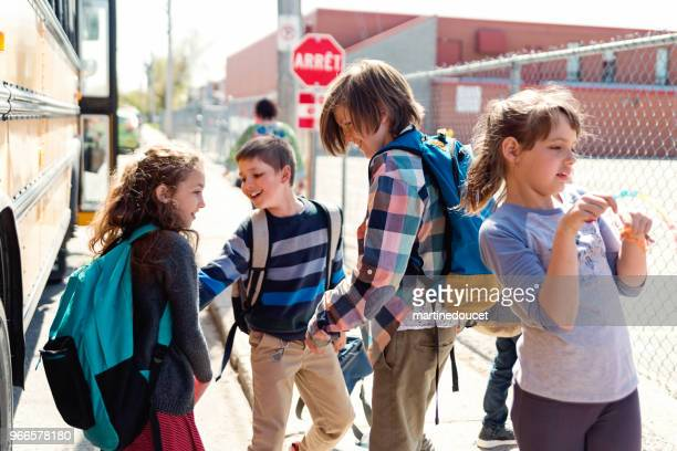 kids goofing aroung getting out of school bus. - teasing stock pictures, royalty-free photos & images
