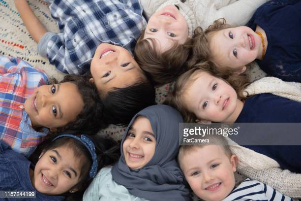 kids group photo - montessori education stock pictures, royalty-free photos & images