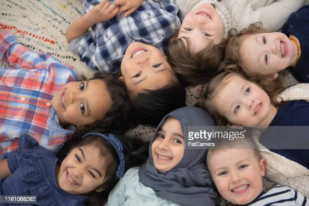 kids group photo - emigration and immigration stock pictures, royalty-free photos & images