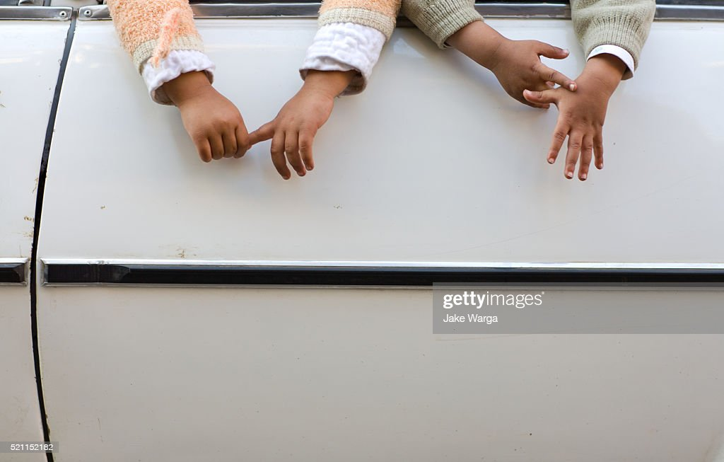 Kids hands dangling out of car window, Cairo, Egypt : Stock Photo
