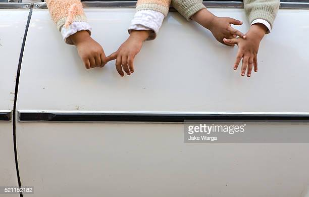 kids hands dangling out of car window, cairo, egypt - jake warga stock photos and pictures