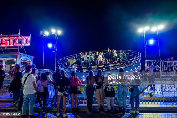 Kids have fun on the Tagadà attraction, on the first day of the Luna Park opening in Molfetta on 4 September 2021. On the occasion of the Patronal...
