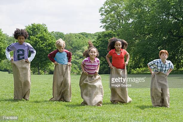Kids having a sack race