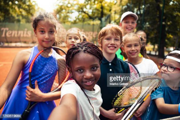 kids having a selfie playing tennis - diversity stock pictures, royalty-free photos & images