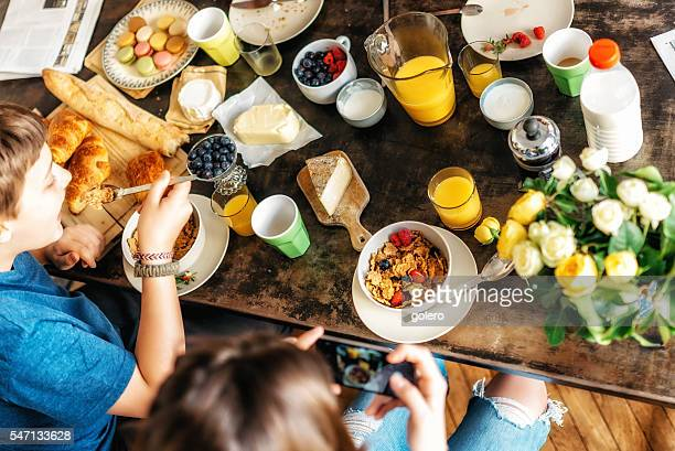 kids having breakfast together at weekend