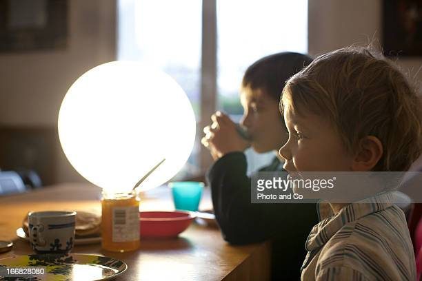 kids having breakfast with light therapy lamp