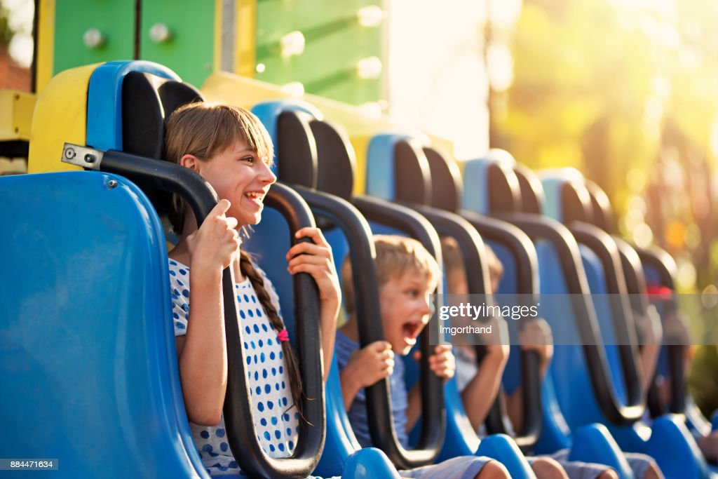 Kids having extreme fun in amusement park drop tower : Stock Photo