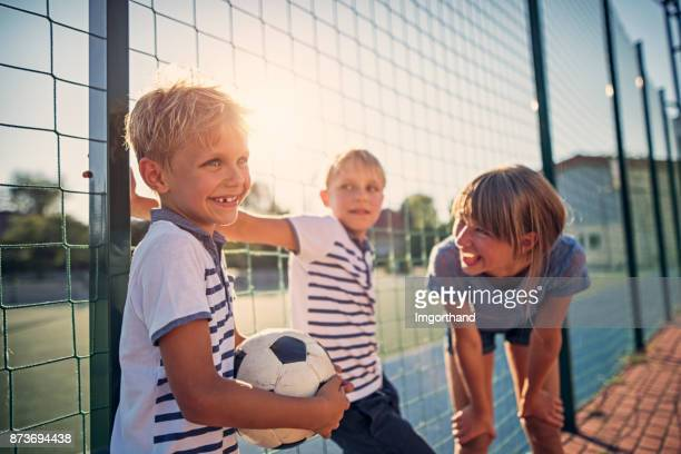 kids having fun at the schoolyard - termine sportivo foto e immagini stock