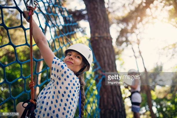 kids having fun during in ropes course  adventure park - outdoor pursuit stock pictures, royalty-free photos & images