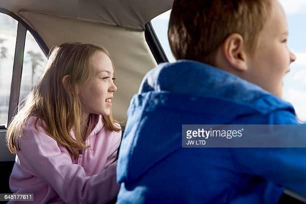 Kids having fun in back of vintage car