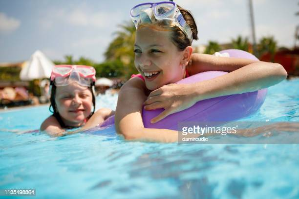 kids having fun in swimming pool - damircudic stock photos and pictures