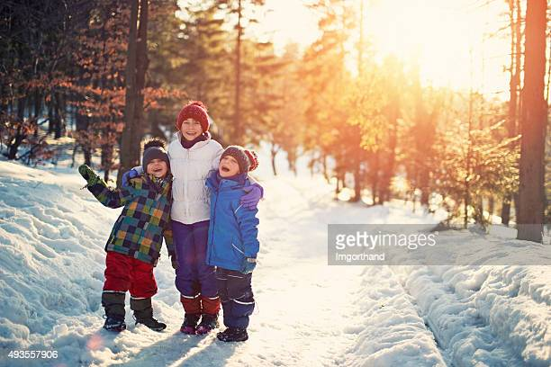 Kids having fun in winter forest