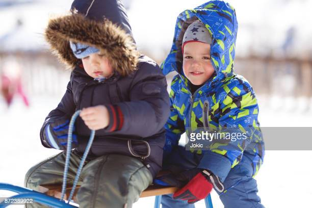 Kids having fun in winter .