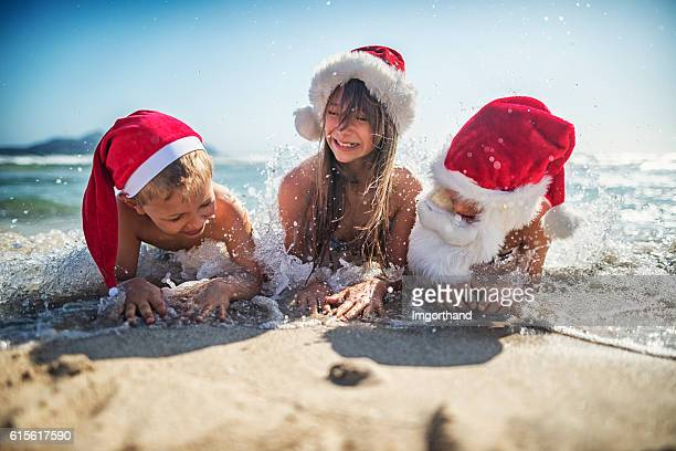 Kids having fun on the beach during Christmas