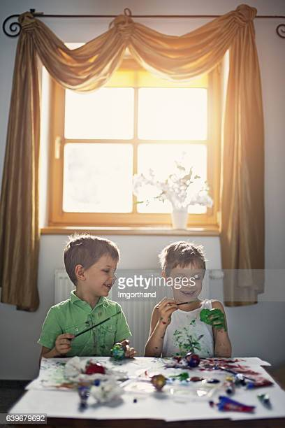 kids having fun painting easter eggs - dirty easter stock pictures, royalty-free photos & images