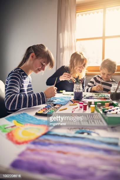 Kids having fun painting with watercolors