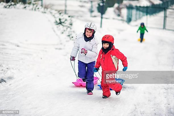 Kids having fun tobogganing