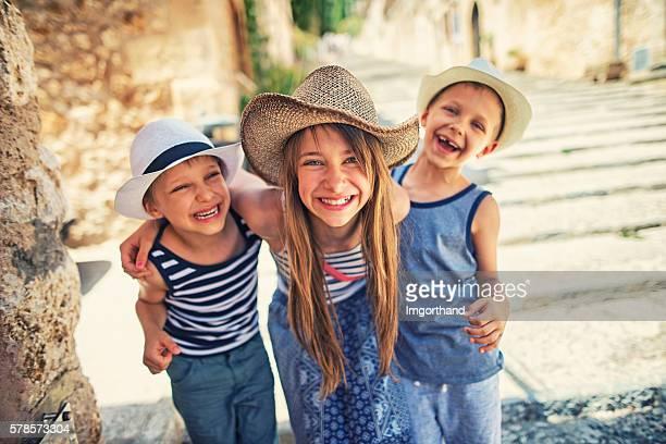 Kids having fun visiting the beautiful Majorcan town of Pollenca