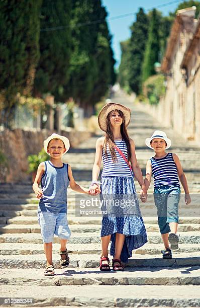 Kids having fun visiting the beautiful Majorcan town of Pollenca