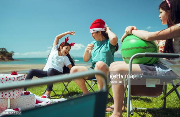 Kids having fun while celebrating Christmas out at beach.