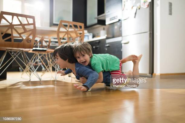 Kids having fun with a skateboard indoor