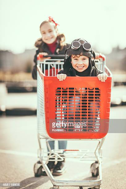 Kids having fun with shopping cart