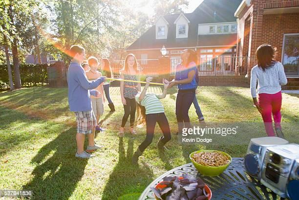 Kids (8-9) having garden party