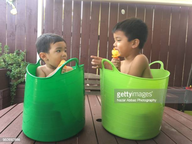 Kids having ice block in a hot summer day.