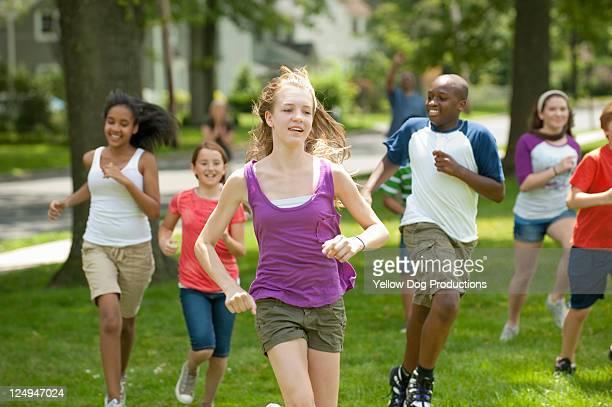 Kids Having Running Race in Neighborhood