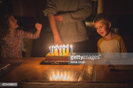 Kids helping parent celebrate birthday