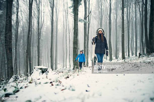 kids hiking in misty winter forest - imgorthand stock photos and pictures