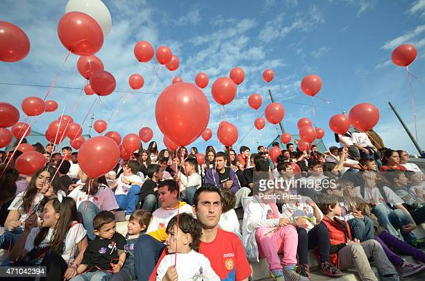 Kids hold red balloons symbolizing the victims of the GenocideArmenians that live in Greece organised a demonstration to remember the 15 million...