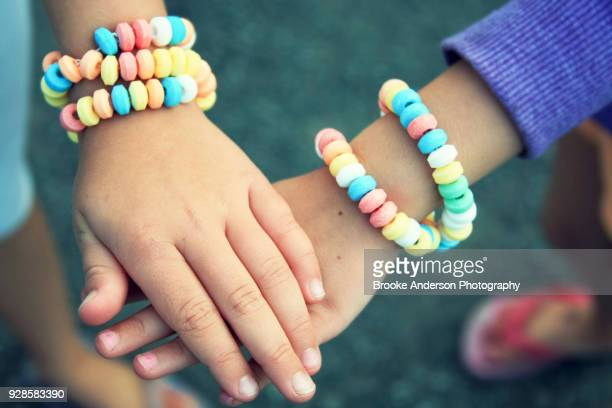 Kids Holding Hands With Candy Bracelets