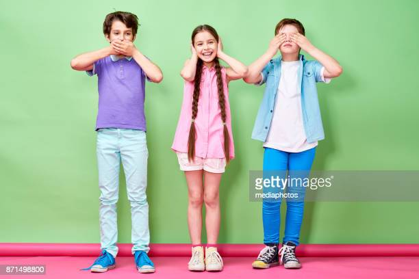 kids imitating three wise monkeys - see no evil hear no evil speak no evil stock pictures, royalty-free photos & images