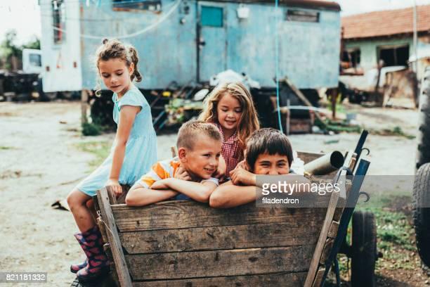 kinderen in een kar met paard - bulgarije stockfoto's en -beelden