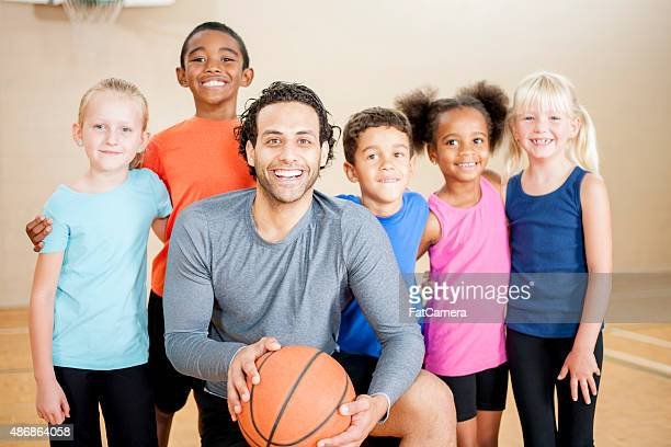 Kids in a Huddle Before a Basketball Game