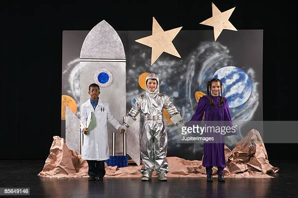 kids in costume on stage - school play stock photos and pictures