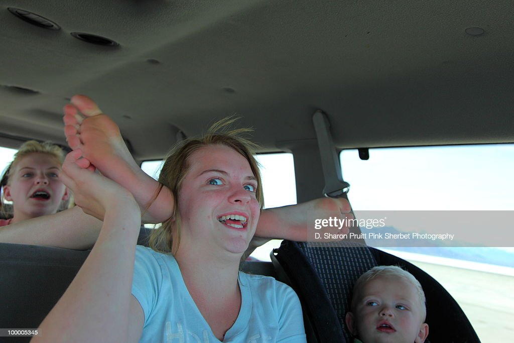 Kids In Family Car With Funny Roadtrip Psychosis : Stock Photo