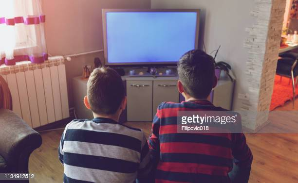 kids in front of tv - flat screen stock pictures, royalty-free photos & images