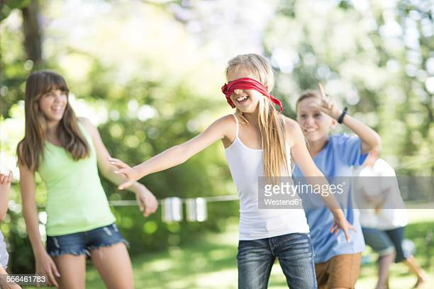 kids in garden playing blind man's buff - blindfolded stock photos and pictures