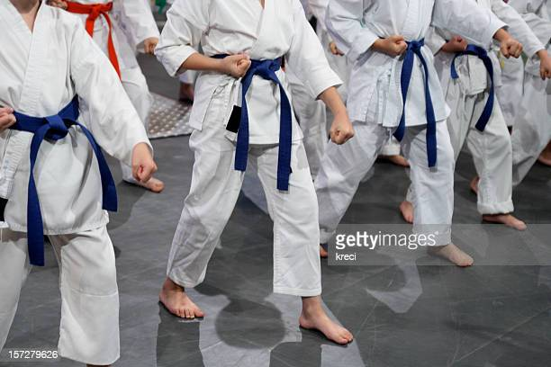 kids in gi. - taekwondo kids stock photos and pictures