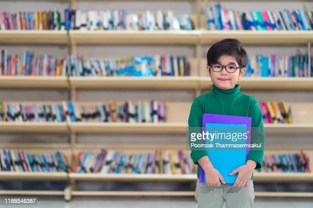 kids in library - knowledge is power stock pictures, royalty-free photos & images