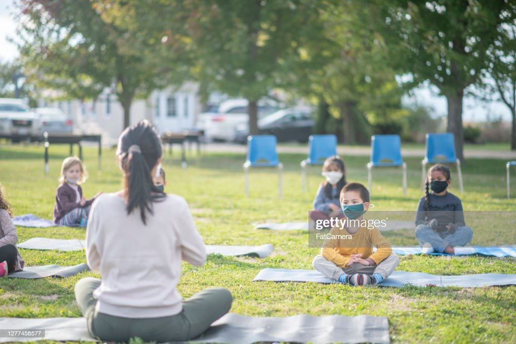 Kids in outdoor fitness class at school : Stock Photo