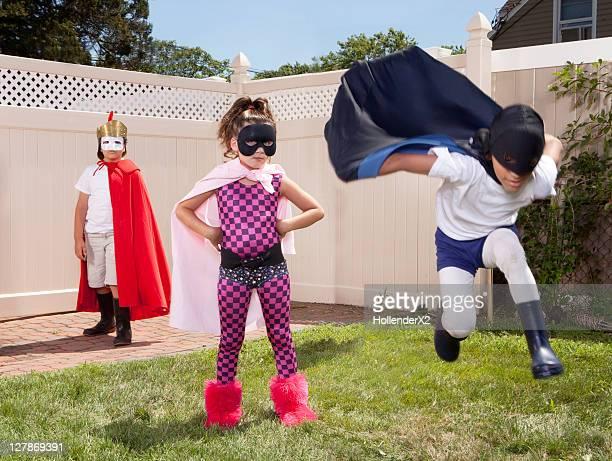 3 kids in superhero outfits - nur kinder stock-fotos und bilder