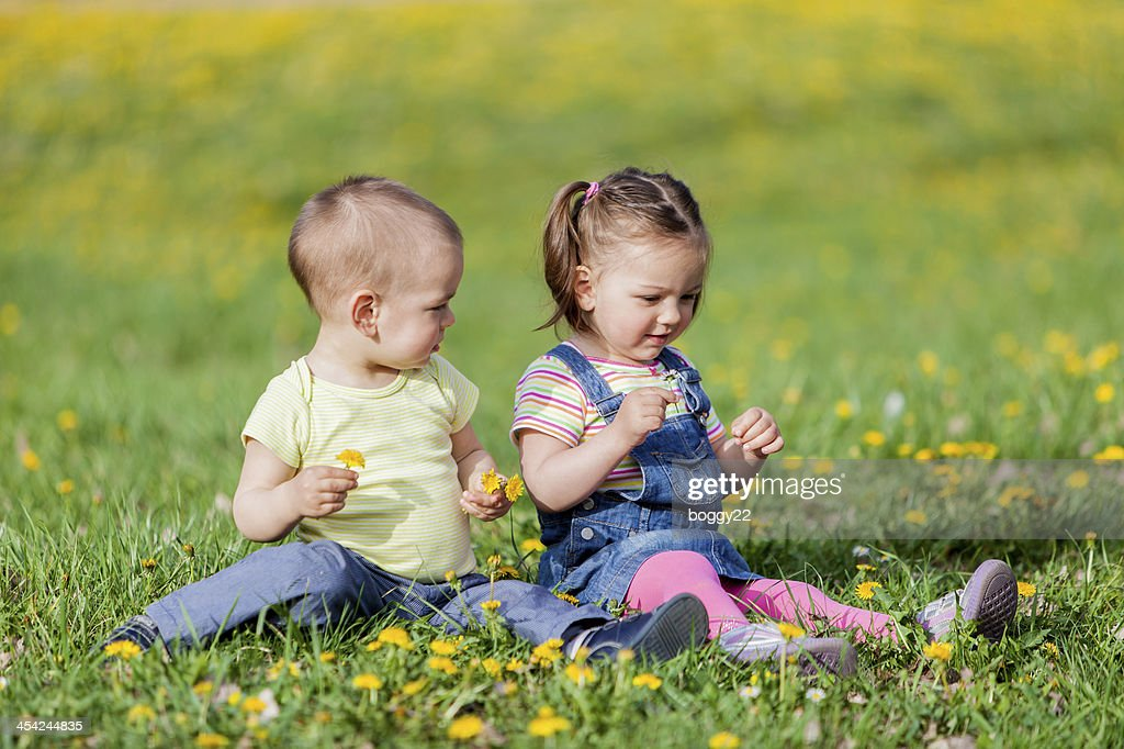 Kids in the spring field : Stock Photo